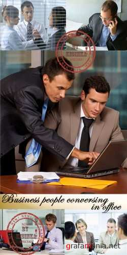 Stock Photo: Business people conversing in office
