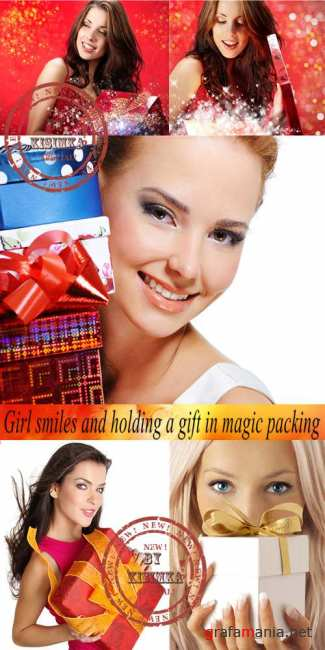 Stock Photo: Girl smiles and holding a gift in magic packing