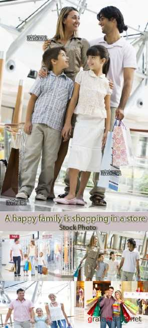 Семья в магазине  Stock Photo: A happy family is shopping in a store
