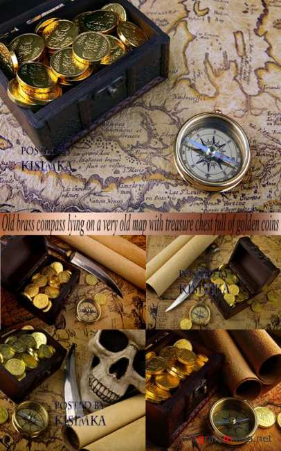 Stock Photo: Old brass compass lying on a very old map with treasure chest full of golden coins