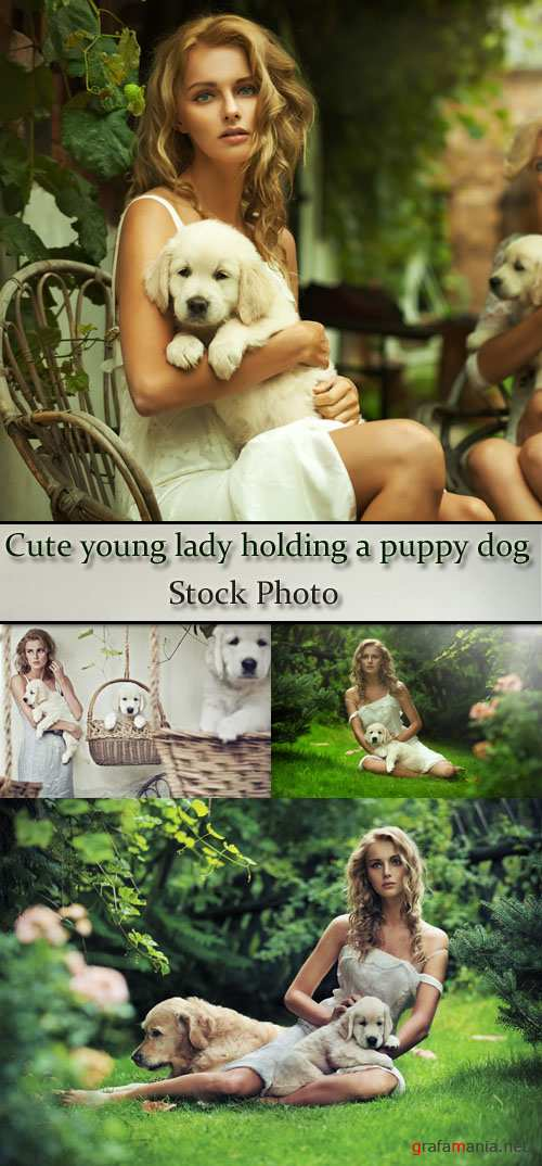 Stock Photo: Cute young lady holding a puppy dog