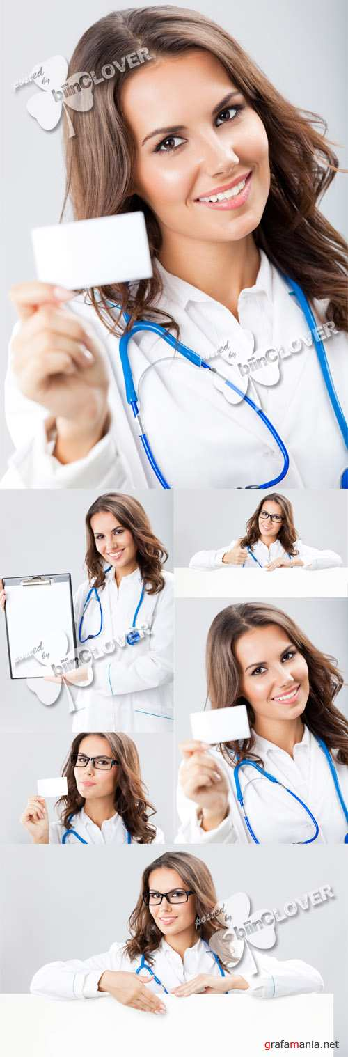 Woman doctor with blank signboard 0383