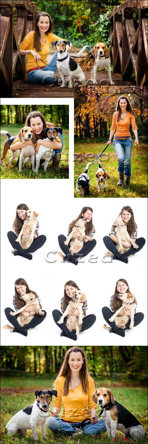 Девушка с собаками / Woman with dogs in the forest - stock photo