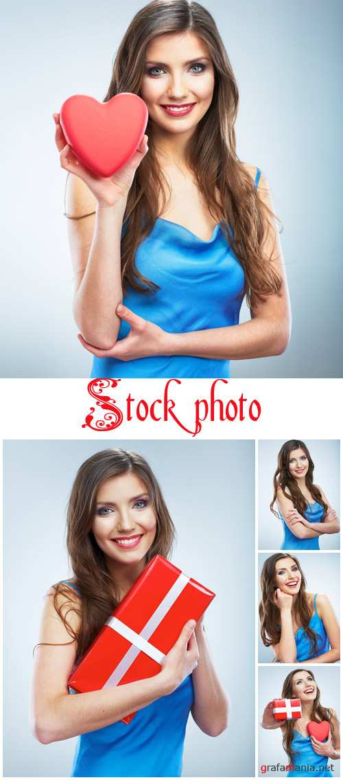 Young happy woman hold Love symbol red heart - stock photo