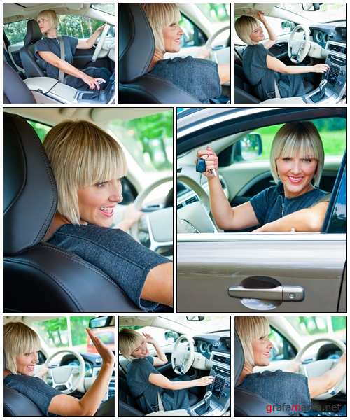 Attractive woman driver in her car - Stock Photo