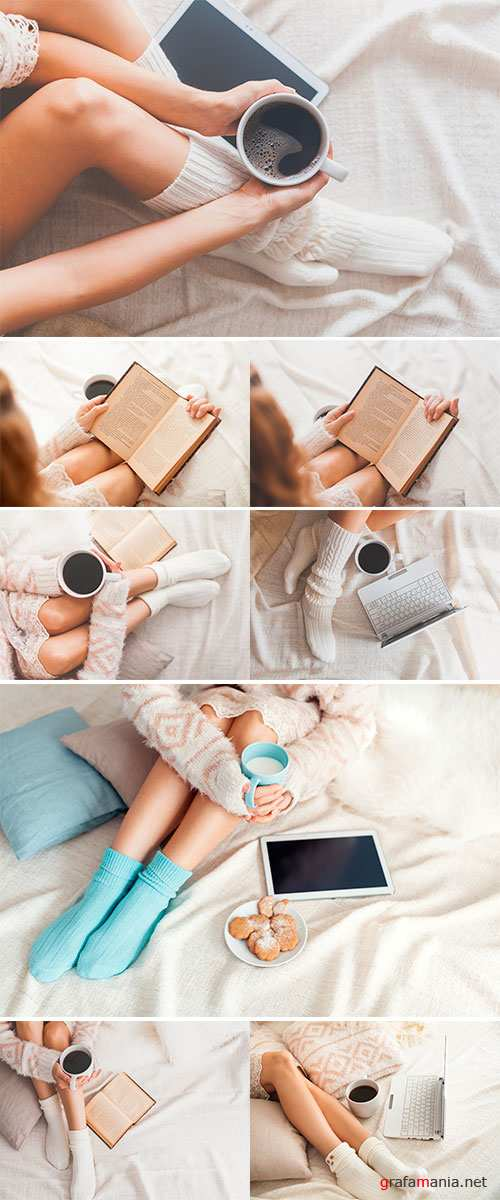 Stock Photo: Soft photo of woman on the bed with old book and cup of coffee in hands, top view point