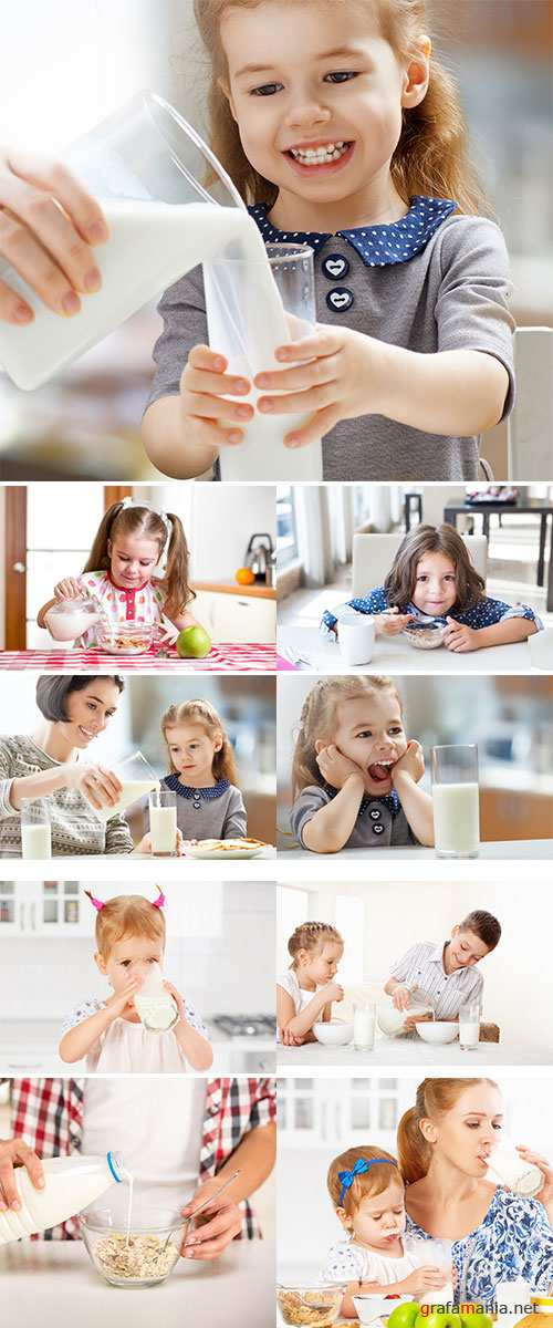 Stock Photo Happy family mother and baby daughter child girl at breakfast biscuits with milk