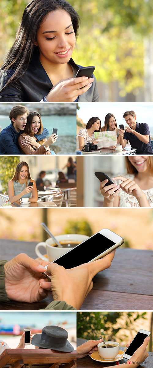 Stock Photo Close-up Of People Holding Mobile Phone