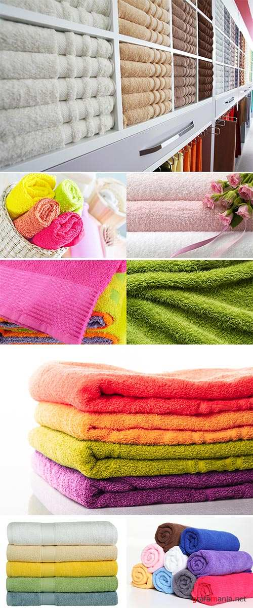 Stock Photo Colorful towels on wooden table on window background