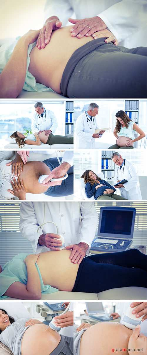 Doctor examining pregnant woman in clinic - Stock Image