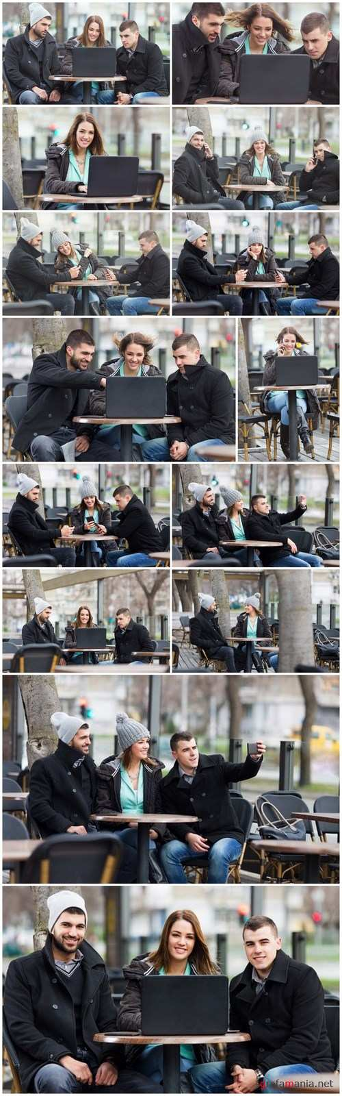 Group of students is sitting in an outdoor cafe and using laptop - 14xUHQ JPEG Photo Stock