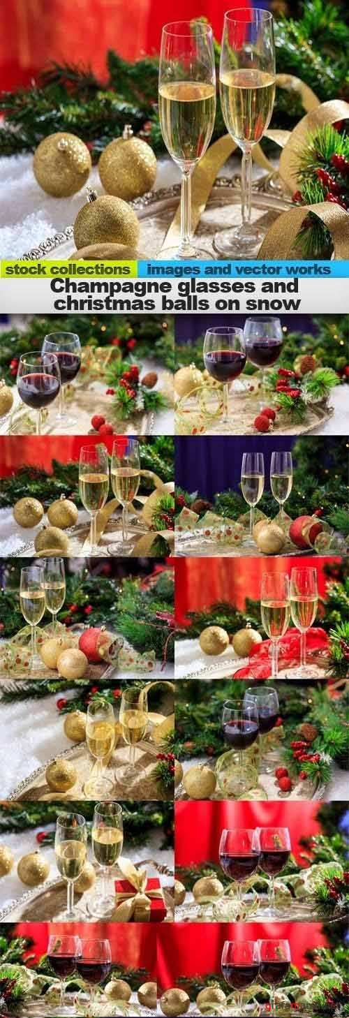 Champagne glasses and christmas balls on snow