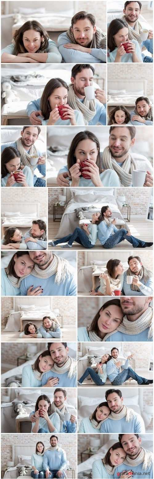 Happy young couple in a cozy bedroom - 20xUHQ JPEG Photo Stock