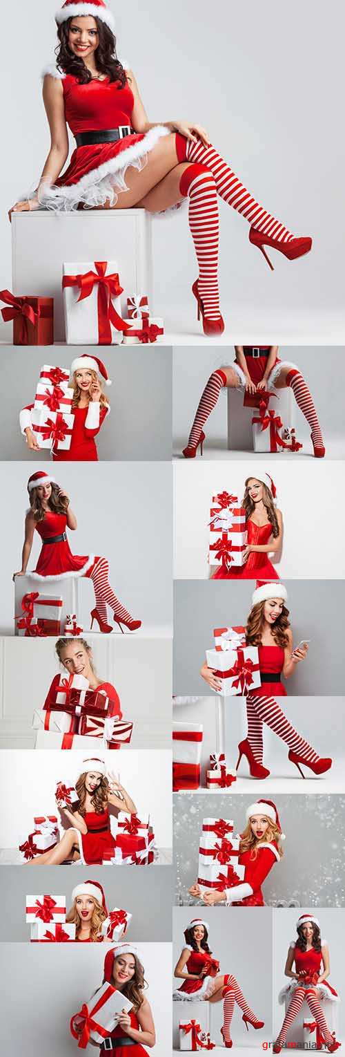 Beautiful girl in suit Santa with Christmas gifts